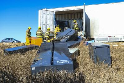 Truck hauling Amazon lockers catches fire east of Overton on I-80