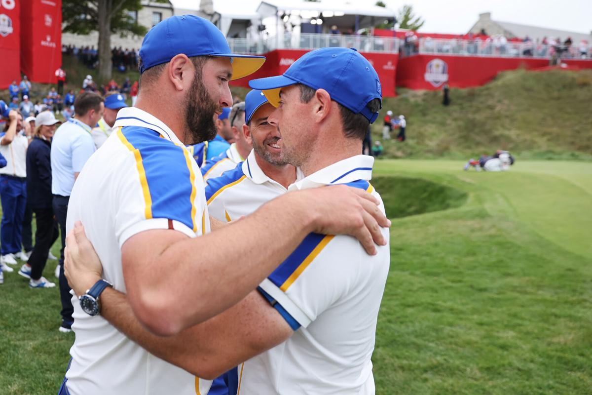 Team Europe members Jon Rahm of Spain, Sergio Garcia of Spain and Rory McIlroy of Northern Ireland embrace after Team United States defeated Team Europe 19 to 9 during Sunday Singles Matches of the 43rd Ryder Cup at Whistling Straits on September 26, 2021 in Kohler, Wisconsin.