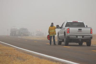 Tanker truck, car collide on foggy Highway 97