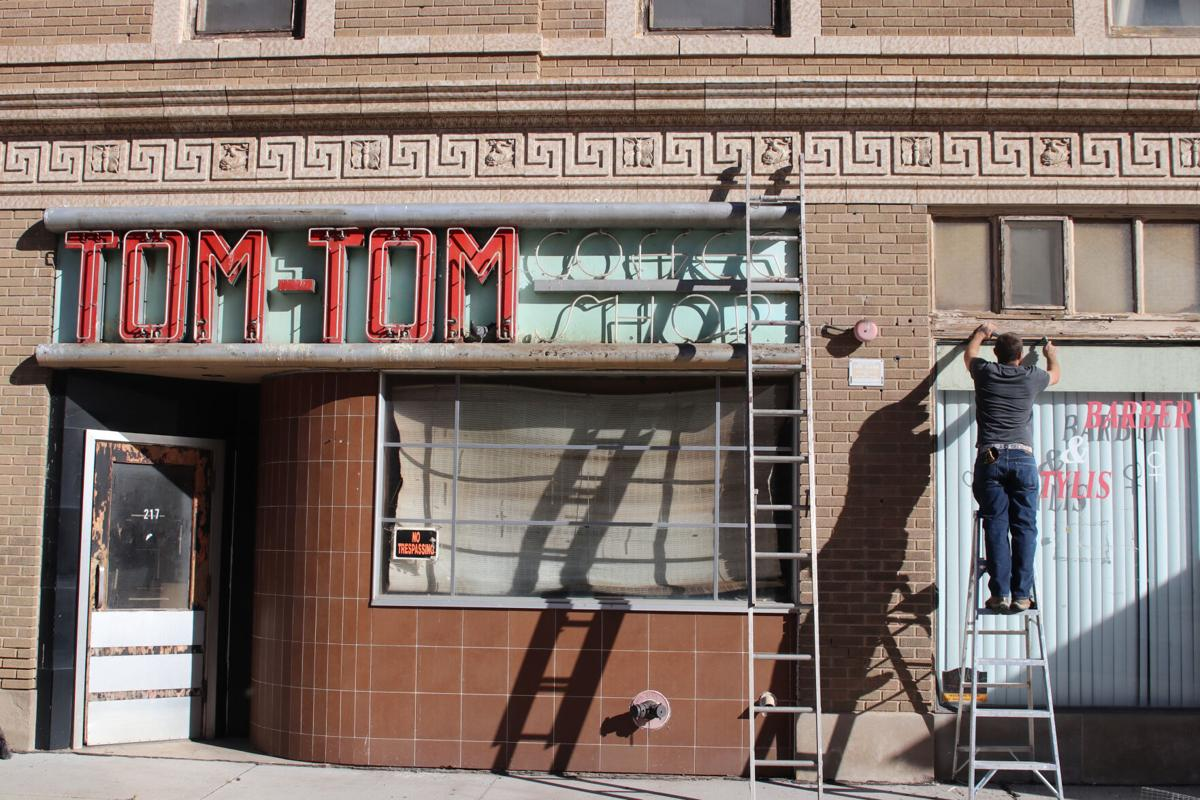 Hotel Pawnee's Tom-Tom Coffee Shop sign uncovered