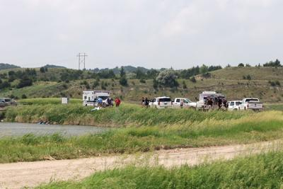 Two die after car rolls into canal near For McPherson National Cemetery, near Maxwell