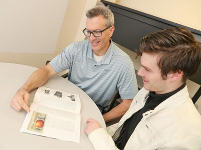 'Giant Grasshoppers and Two-Ton Potatoes':  Father-son research team studies history of state's exaggerated postcards