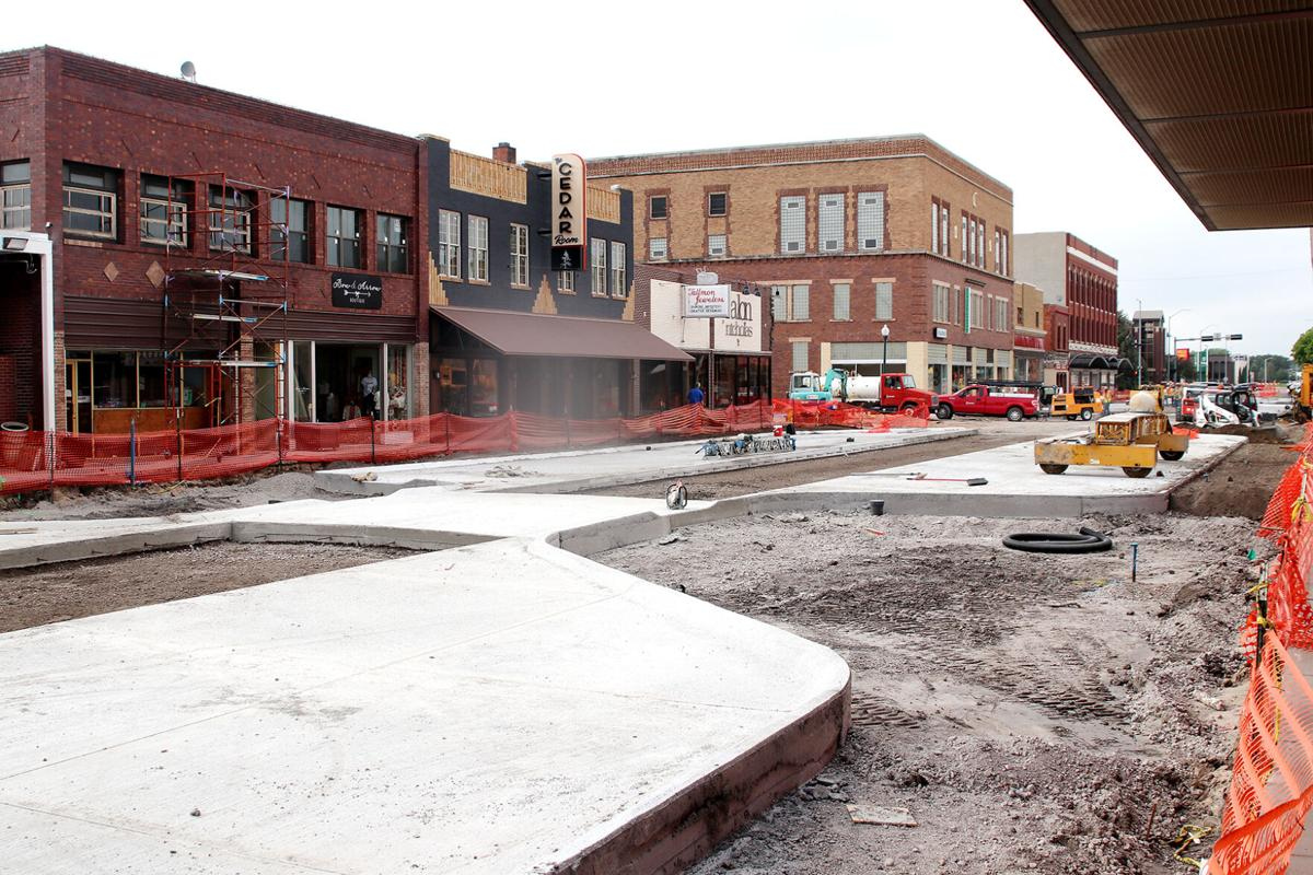 Closer to completion: Construction crews finishing concrete work along Dewey