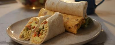 Conquer life on-the-go with this cheesy and nutritious breakfast burrito