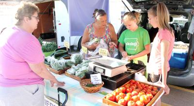 Area farmers set up shop for summertime tradition