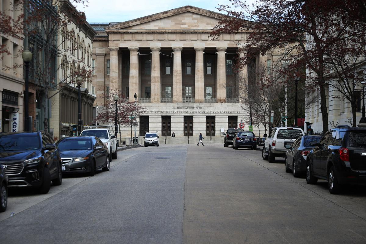 The Smithsonian National Portrait Gallery stands in the Penn Quarter neighborhood of Washington, D.C., which is unusually empty of vehicle traffic and pedestrians due to the coronavirus outbreak, on March 17, 2020.