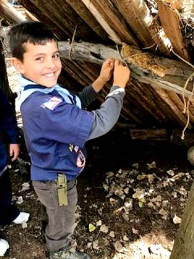Scouts learn survival skills and how to cook outdoors