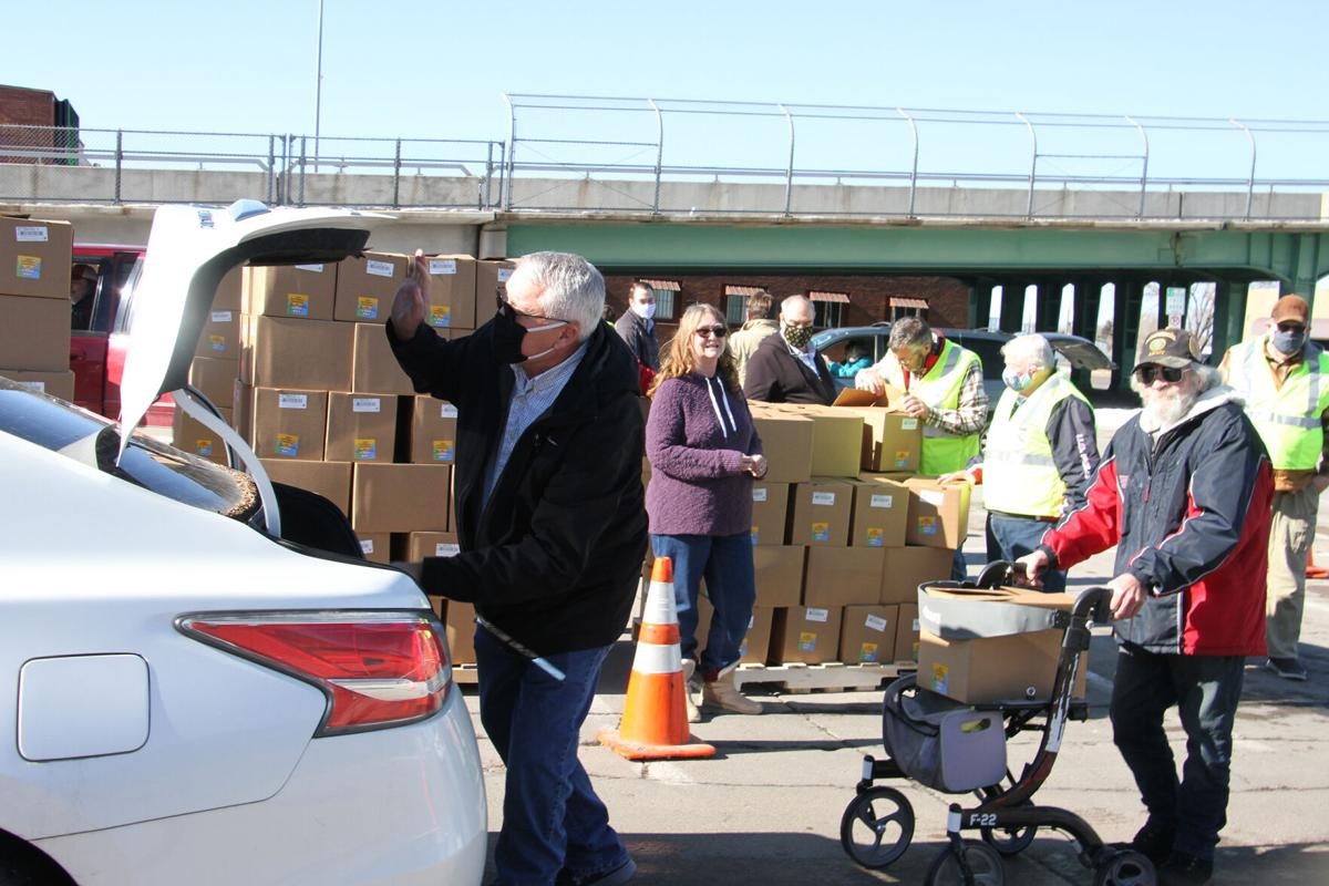 Watch now: North Platte Rotarians distribute 1,200 boxes of food