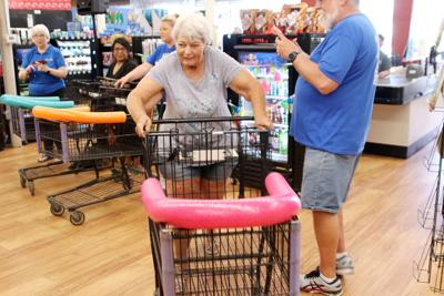 Watch now: Winner tabs $297 prize at Noon Rotary's 'Grocery Grab'