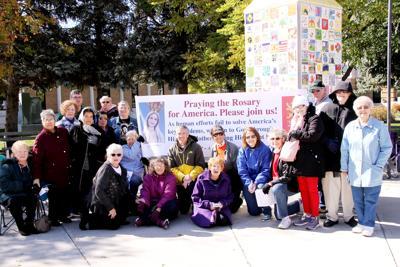 Catholics gather to pray rosary Saturday