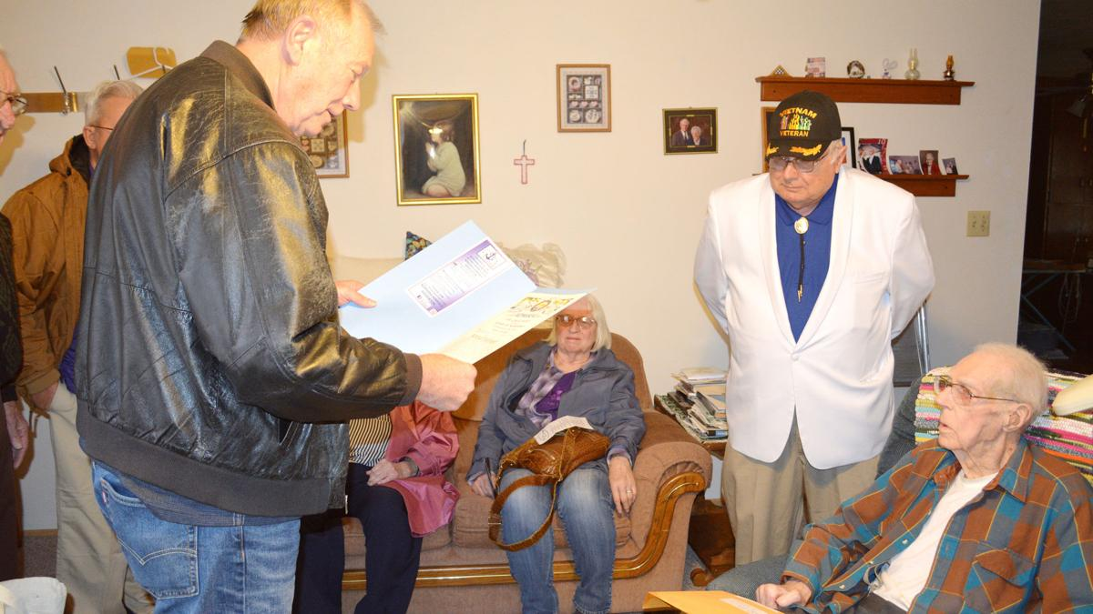At the age of 99, Norval Holtmeier is inducted into the Great Navy of the State of Nebraska