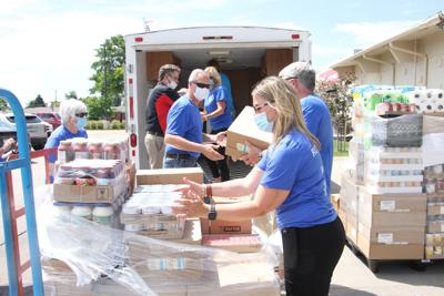 Noon Rotary, Gary's Super Foods help stock local pantries