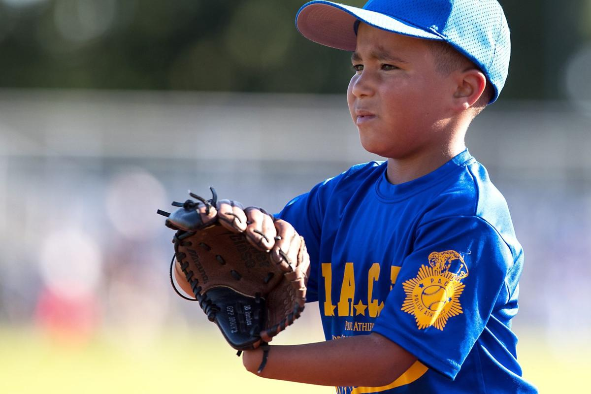 What handicap? 7-year-old born without left hand catches on quickly to baseball