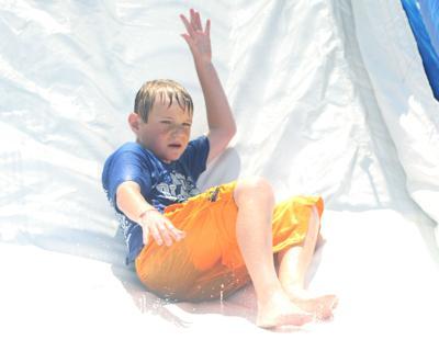 County fairgoers ride the slide