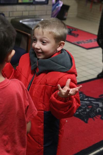 Warming hearts and hands: Firefighters give 15 kids brand  new winter coats
