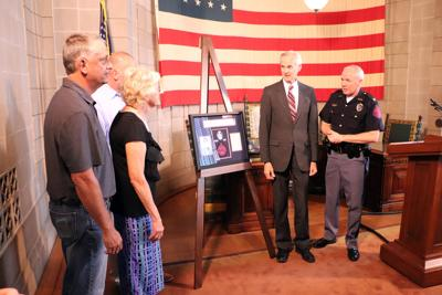 Family of slain Trooper given piece of NSP history