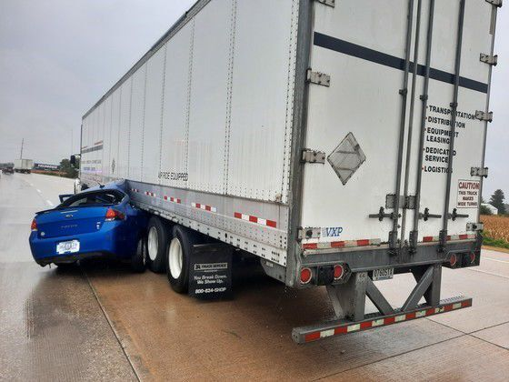 Car ends up wedged under truck on Interstate 65