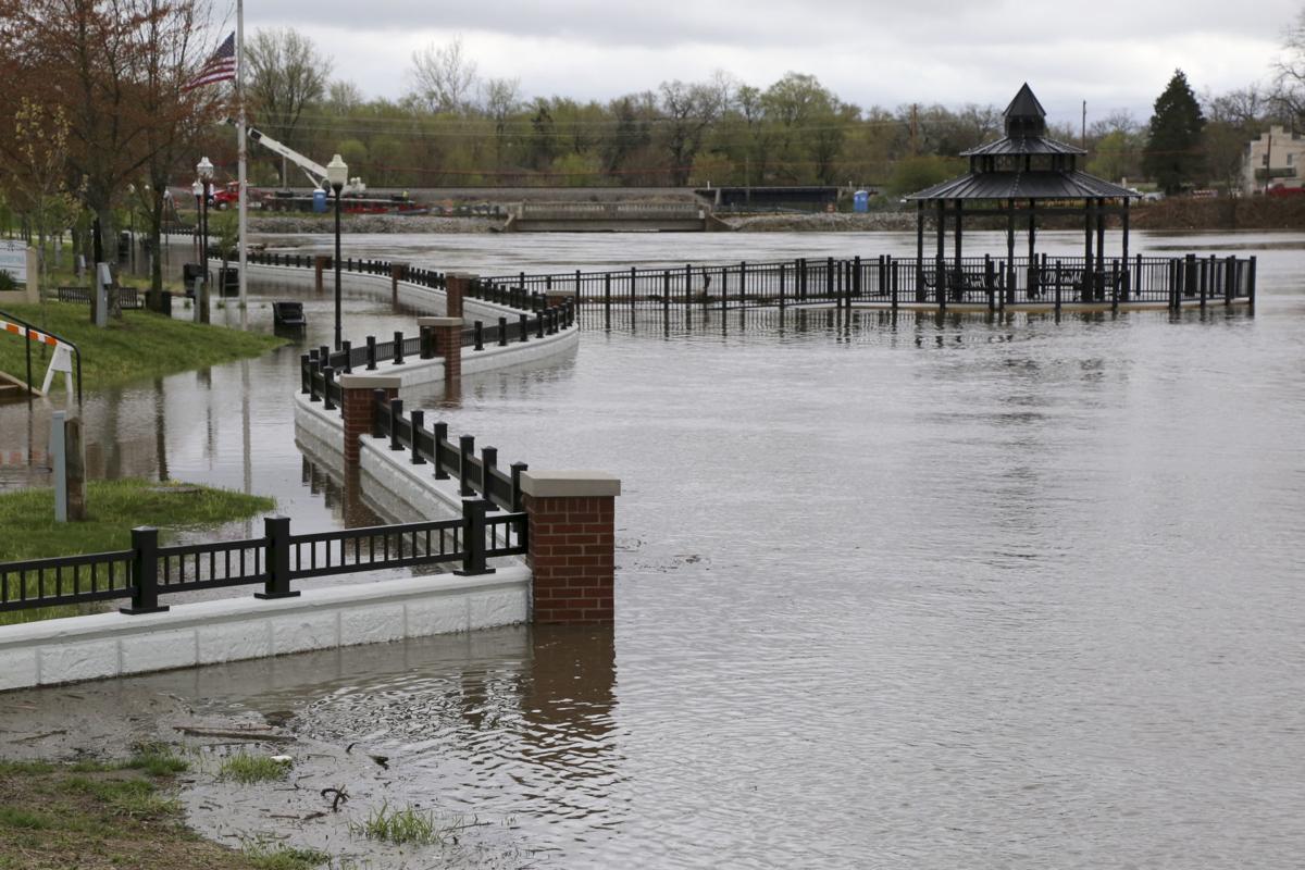 UPDATE: Drivers navigate through standing water, around road