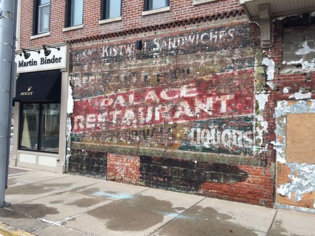 Sign for old Palace Restaurant exposed during building renovation