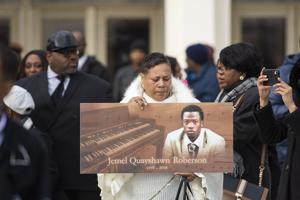 Mourners attend funeral for security guard shot by officer