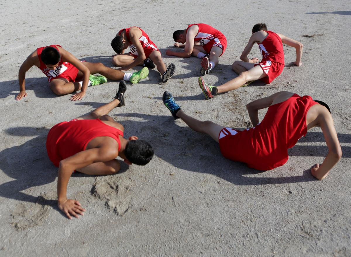 Morton runners stretch before the Highland Invitational (copy)