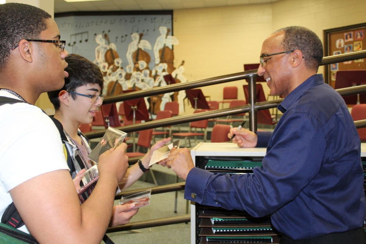 Renowned composer visits Merrillville High; works with music club