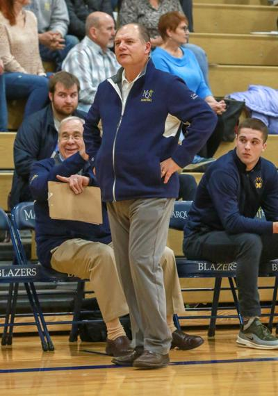 Marquette Catholic boys basketball coach Fred Mooney