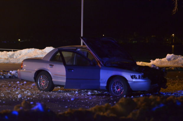 2 hurt, car ends up on ice in Cedar Lake crash