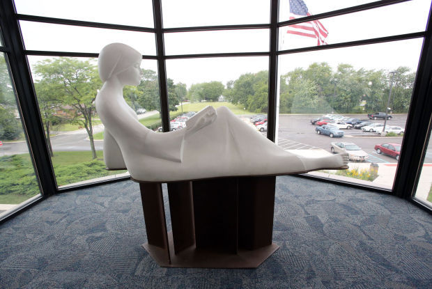 The Reader statue in the main branch of the Lake County Library