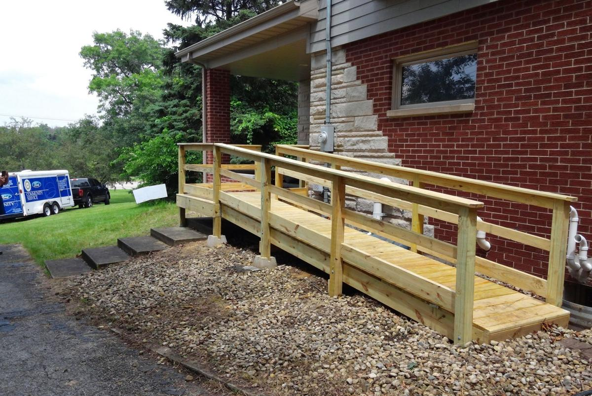 uaw volunteers build wheelchair ramp for youngster portage news