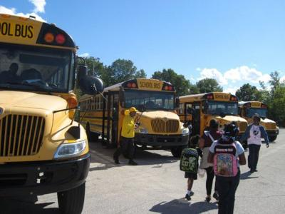Gary administrators ride school buses