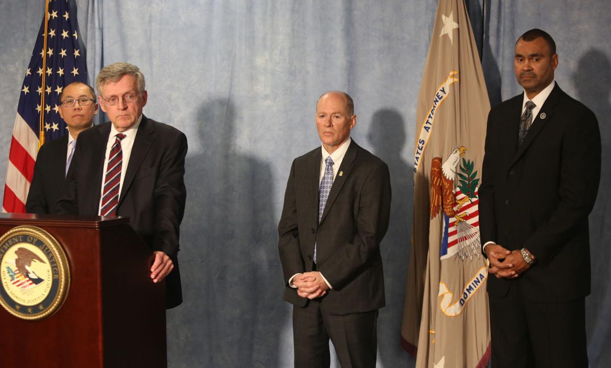 U.S. Attorney David Capp announces public corruption indictments at a press conference Friday.