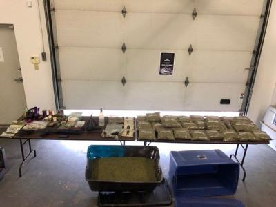 Cops bust drug operation, seize chemicals used to make Spice, guns, cash, police say