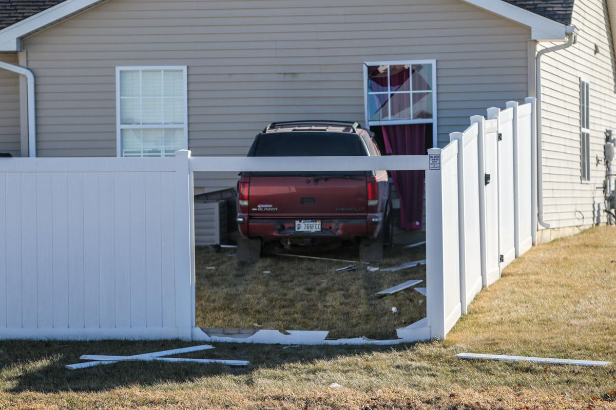 Vehicle rams house