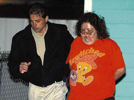 Daughter charged with moving dead dad