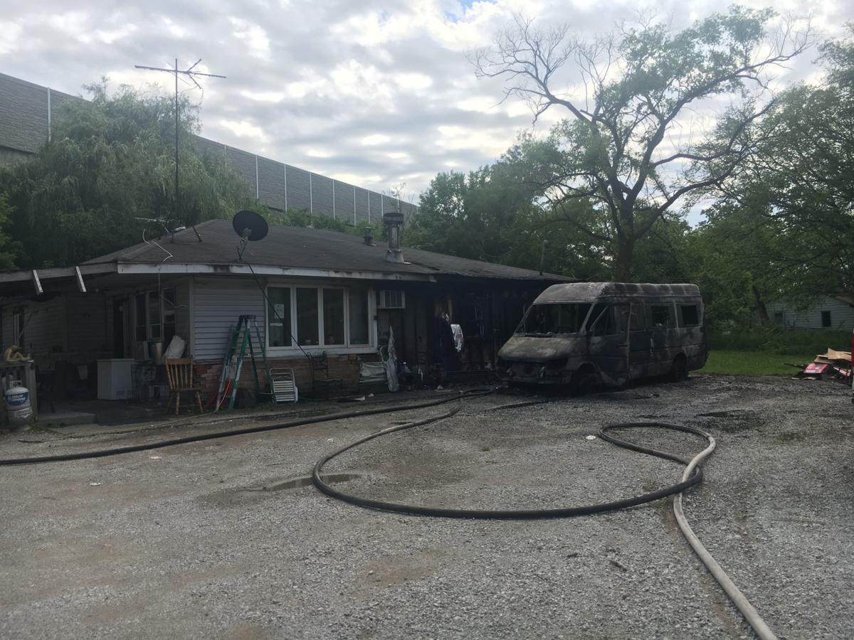 Van engulfed in flames sets family's home ablaze