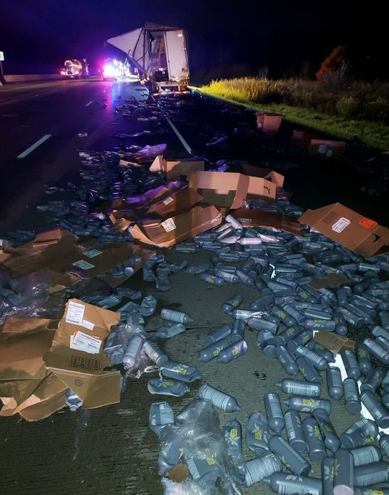 Semi drivers escape injury after one sideswipes the other, filling highway with debris