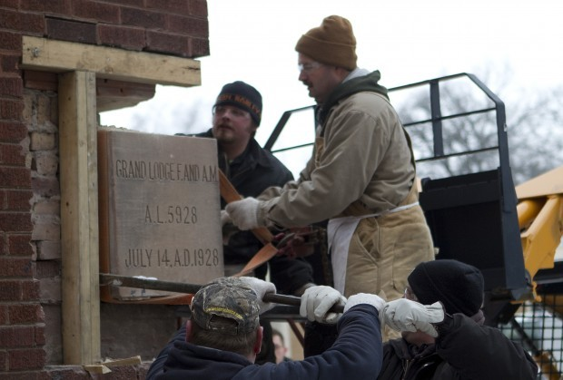 Masons remove old school cornerstone