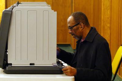 Dr. Walter Watkins votes in referendum