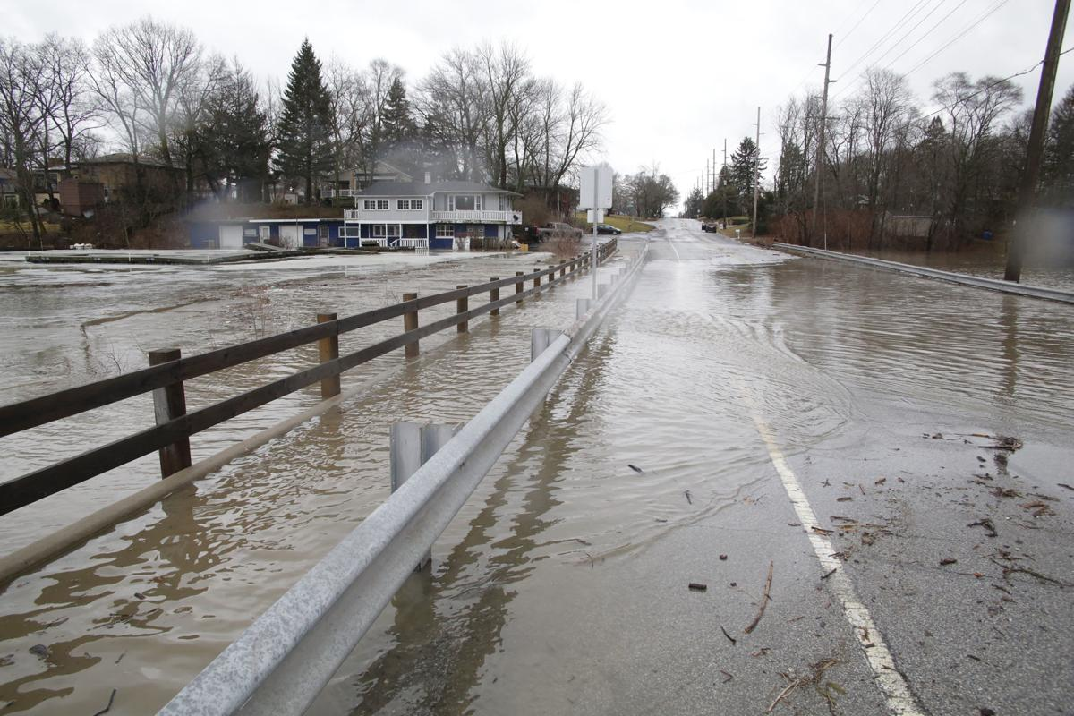 Communities begin to assess damage to roads, bridges from flooding