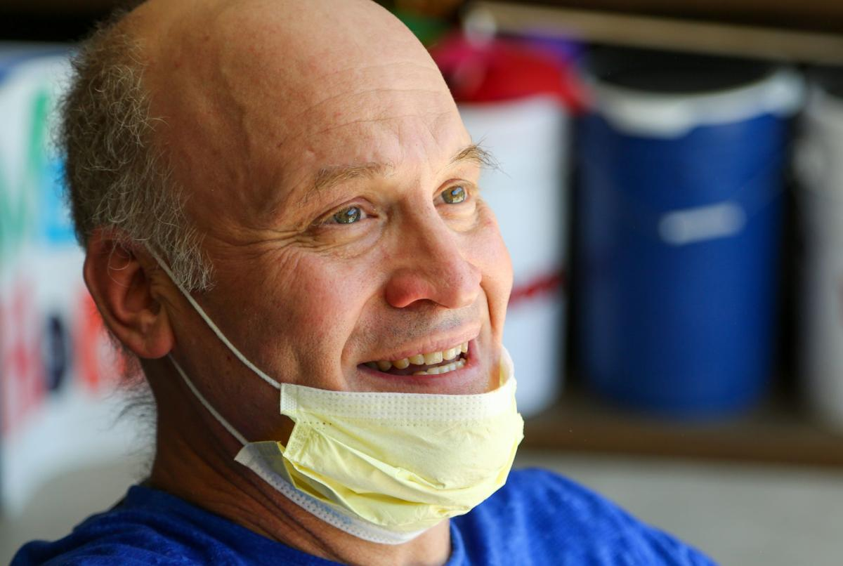 Jim Phillips returns home after being hospitalized with COVID-19 since April