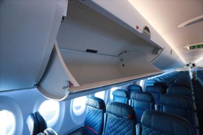 The new Delta A220 aircraft features bigger high-capacity overhead bins on October 29, 2018, in Atlanta.