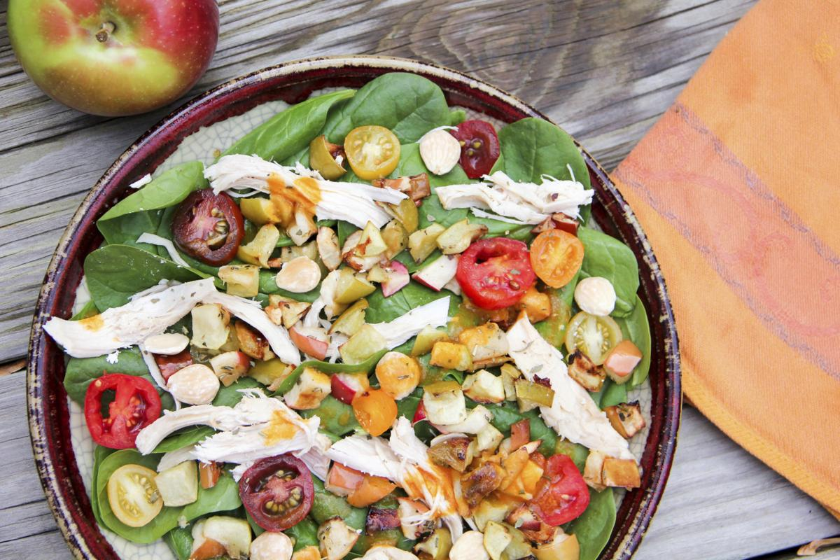 Food Healthy Green Salad with Pumpkin Vinaigrette and Roasted Apples