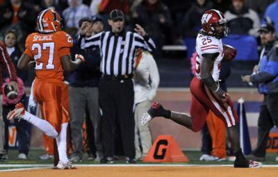 91c422020 Wisconsin running back Melvin Gordon (25) rushes for a touchdown while  Illinois  Eaton Spence (27) trails during the fourth quarter Saturday in  Champaign