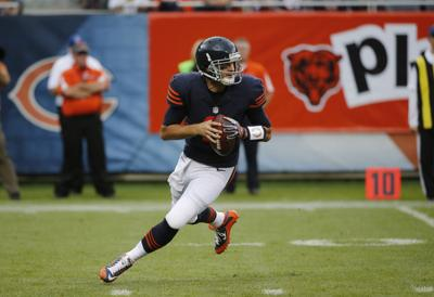 c7db37363f7 Bears quarterback Brian Hoyer scrambles during the first half of Sunday's  game against the Detroit Lions.