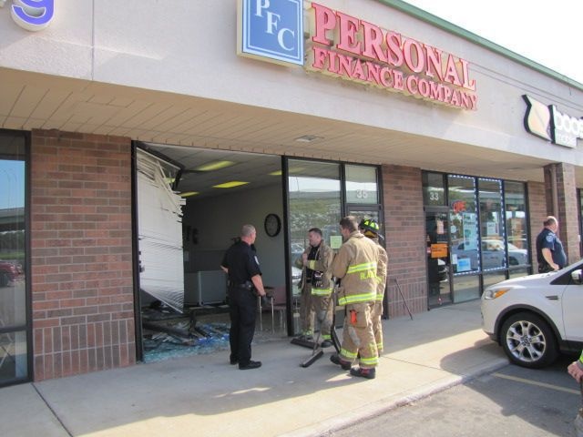 Worker hurt when car crashes into storefront