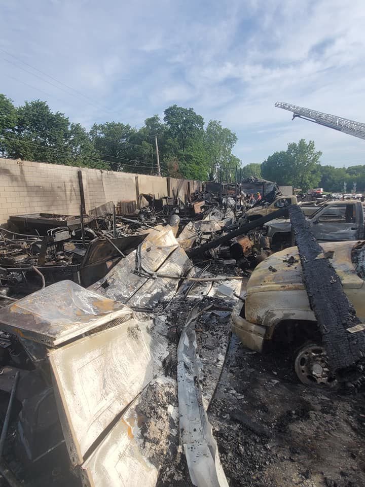 Fire burns building connected to local businesses, row of other property
