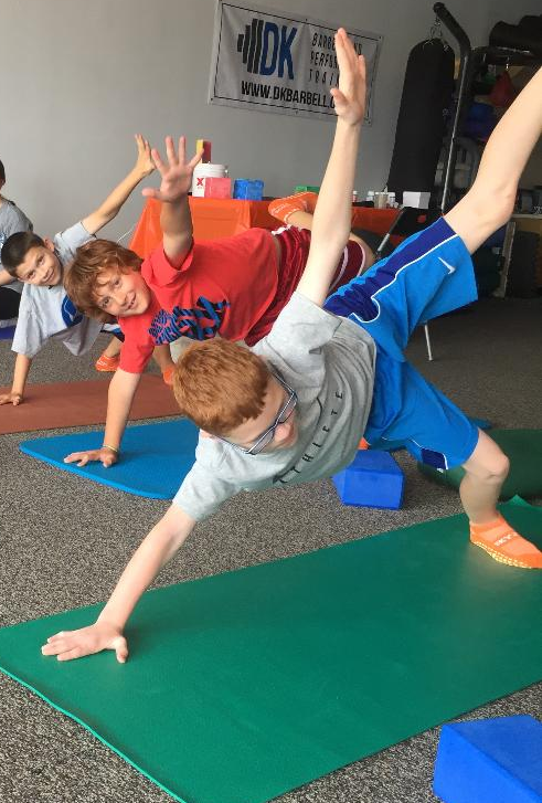 St. John yoga instructor brings the mind/body discipline to junior high students