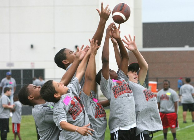 Pierre Thomas campers battle for possession of a thrown pass