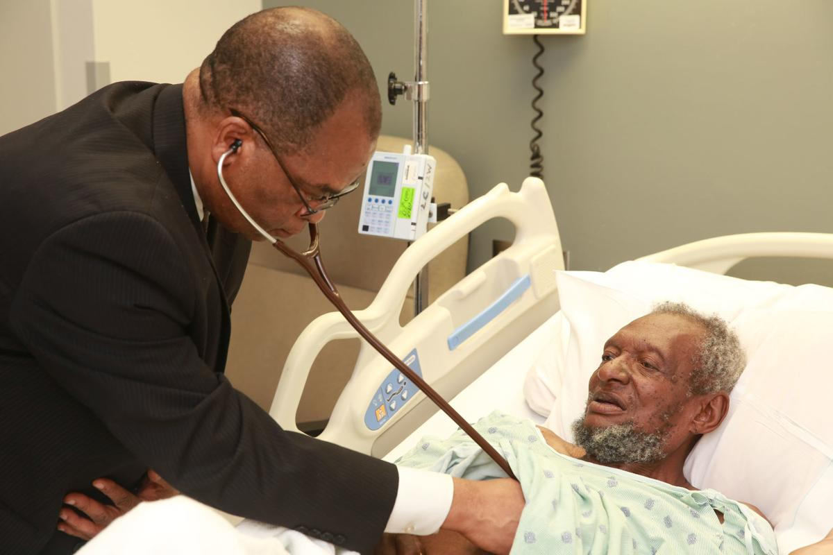 Methodist physician Dr. Adophus Anekwe makes his rounds